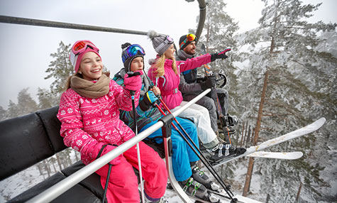 happy family on a ski lift - Club Med