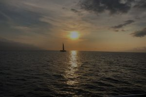 ocean view at sunset with a boat in the distance 300x200 - ocean-view-at-sunset-with-a-boat-in-the-distance