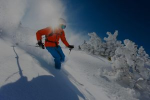 skiier skiing down a snow covered mountain 300x200 - skiier-skiing-down-a-snow-covered-mountain